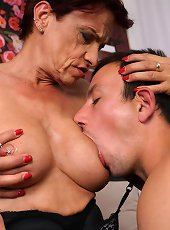 Tattooed pierced grandma playing with vibrator
