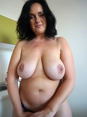 Mature housewife Ria Black gets naked on the kitchen counter.