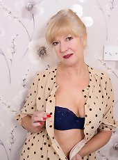 Naughty British housewife getting wet in her bedroom