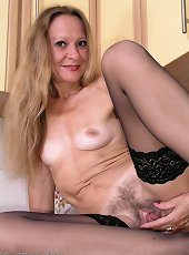Blue eyed mature removes her lingerie on camera